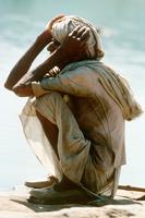 Man on haunches Madya Pradesh India